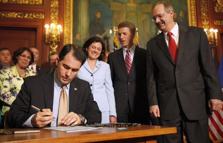 Wisconsin Gov. Scott Walker during a signing ceremony for the Voter ID Bill (AB-7) at the state Capitol in Madison, Wis., Wednesday, May 25, 2011. M.P. King-State Journal