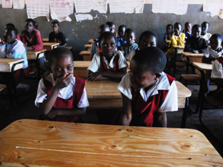 Children in Malawi seated at their new desks. (msnbc/UNICEF)