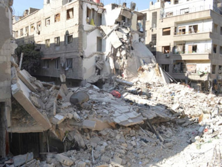 East of Damascus, buildings damaged by what activists said were missiles fired by a Syrian Air Force fighter jet loyal to President Bashar al-Assad
