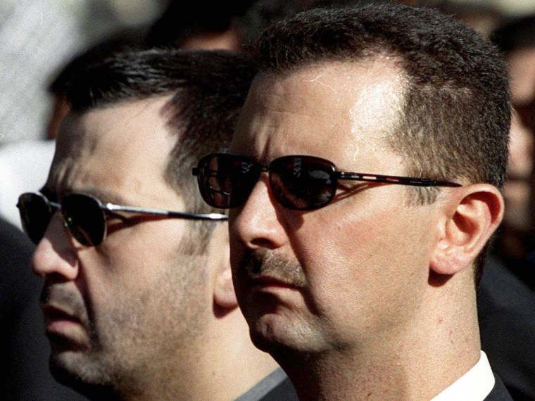 DAMASCUS, SYRIA:  The sons of Syria's late President Hafez al-Assad, Maher (L) and heir apparent, Bashar (R), march behind their father's coffin during his funeral in Damascus 13 June 2000. Assad, who ruled his country with an iron fist for 30 years,...