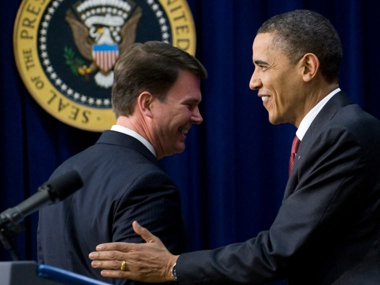 File Photo: US President Barack Obama shakes hands with Office of Personnel Management Director John Berry (L) before speaking during the closing session of the Forum for Workplace Flexibility in the South Court Auditorium in the Eisenhower Executive...