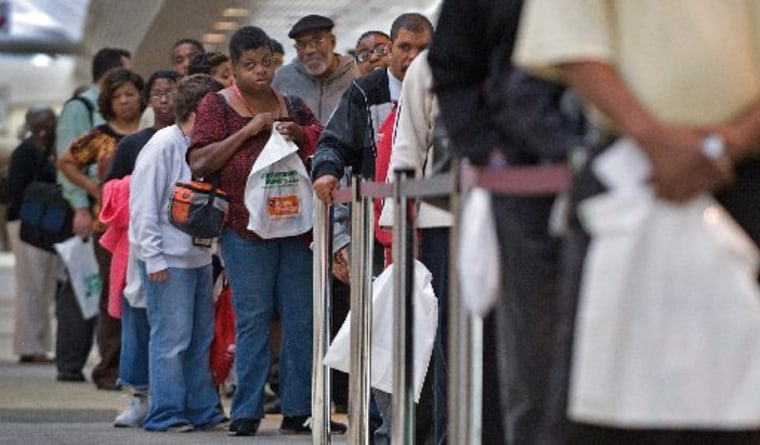 File Photo: People seeking employment line up outside a 2009 job fair in Baltimore, Maryland. Community programs, including job training courses, are under threat in the looming fiscal cliff. (Photo: Paul J. Richards/AFP/Getty Images)