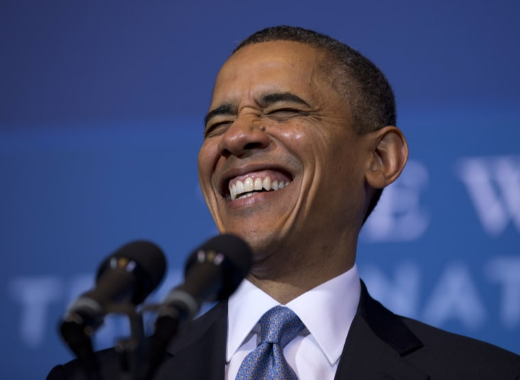 President Barack Obama laughs as he arrives to speak at the 2012 Tribal Nations Conference, Wednesday, Dec. 5, 2012, at the Interior Department in Washington. (Photo by Carolyn Kaster/AP)