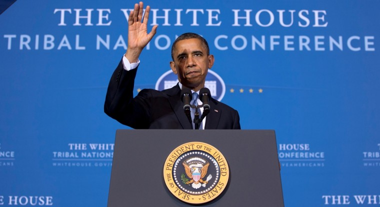 President Barack Obama waves as he arrives to speak at the 2012 Tribal Nations Conference, Wednesday, Dec. 5, 2012, at the Interior Department in Washington. (AP Photo/Carolyn Kaster)