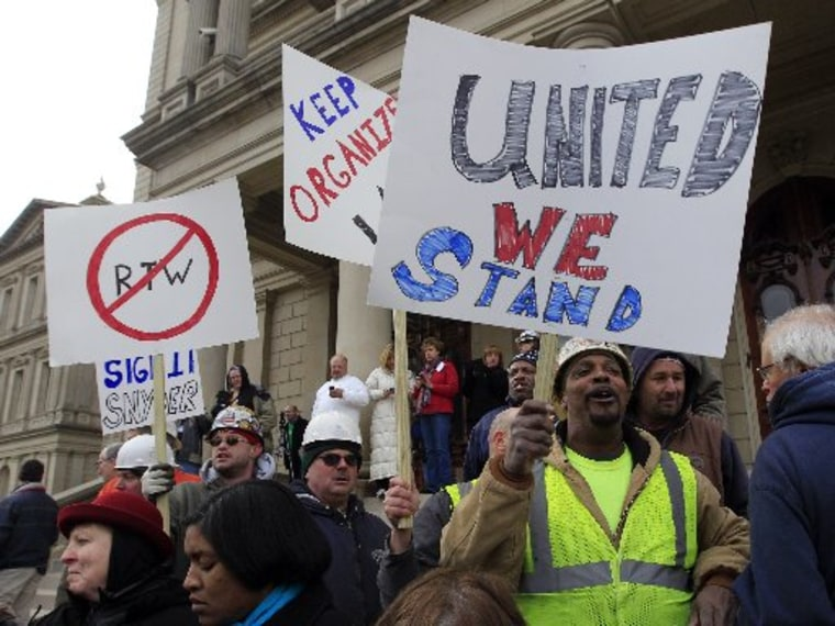 Union workers rally outside the Capitol in Lansing, Mich., Dec. 6, 2012, as Senate Republicans introduced right-to-work legislation in the waning days of the legislative session. The outnumbered Democrats pledged to resist the proposal and said rushing...