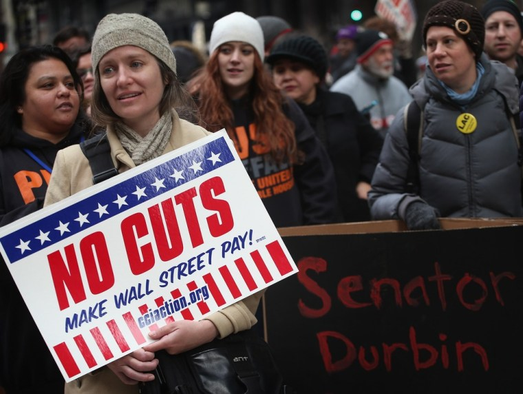 Protestors call for an increase of taxes on the wealthy and voice opposition to cuts in Social Security, Medicare, and Medicaid during a demonstration in the Federal Building Plaza on December 6, 2012 in Chicago, Illinois. (Photo by Scott Olson/Getty...