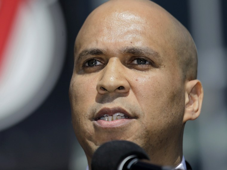 File Photo: Newark Mayor Cory Booker talks during a news conference outside of the Prudential Center, Wednesday, April 4, 2012, in Newark, N.J., (Photo by Julio Cortez/AP Photo File)