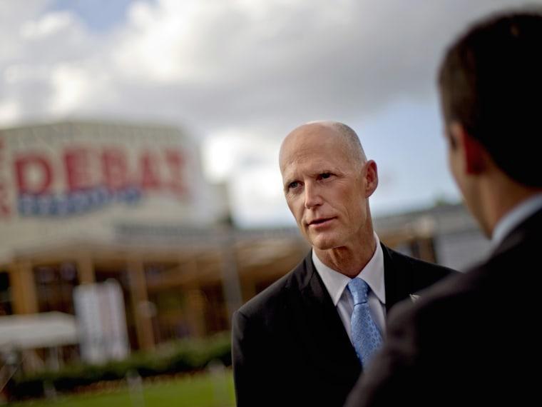 File Photo: Florida Gov. Rick Scott, (Photo by David Goldman/AP)