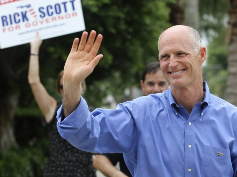 File Photo: Florida Republican Gubernatorial candidate Rick Scott greets supporters near his precinct Tuesday Aug. 24, 2010, in Naples, Fla. (Photo by Erik Kellar/AP Photo/File)