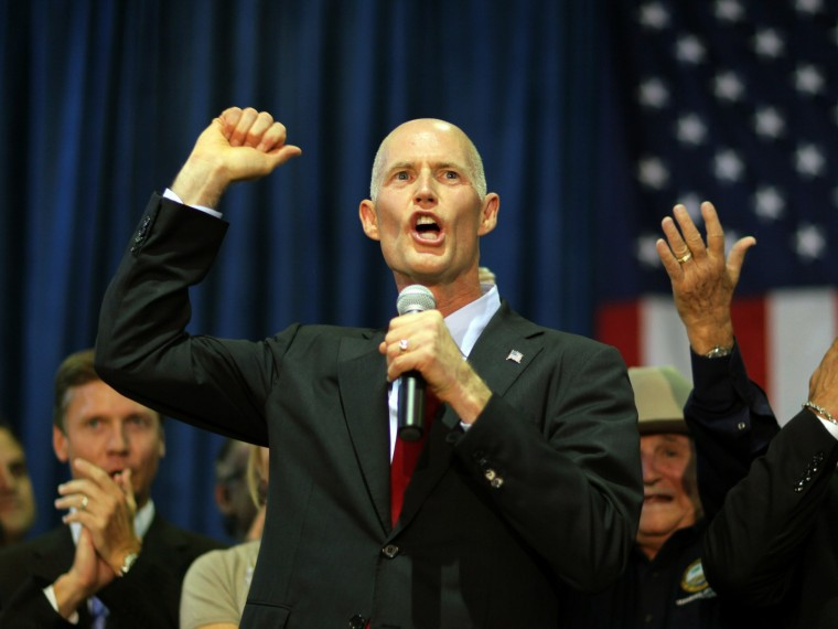 File Photo: Rick Scott, the Republican candidate for governor of Florida, as he campaigns at the Sweetwater Youth Center on August 31, 2010 in Sweetwater, Florida.  (Photo by Joe Raedle/Getty Images/File)