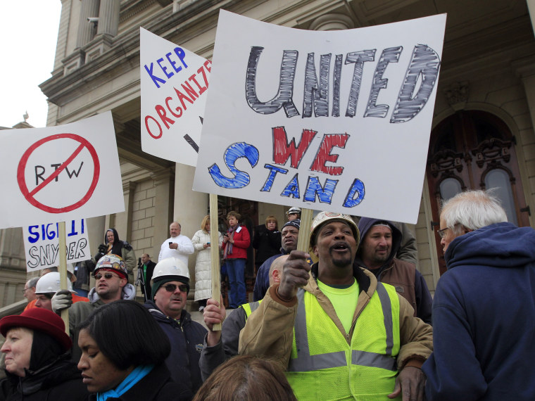 Union workers rally outside the Capitol in Lansing, Mich., Thursday, Dec. 6, 2012 as Senate Republicans introduced right-to-work legislation in the waning days of the legislative session. The outnumbered Democrats pledged to resist the proposal and...