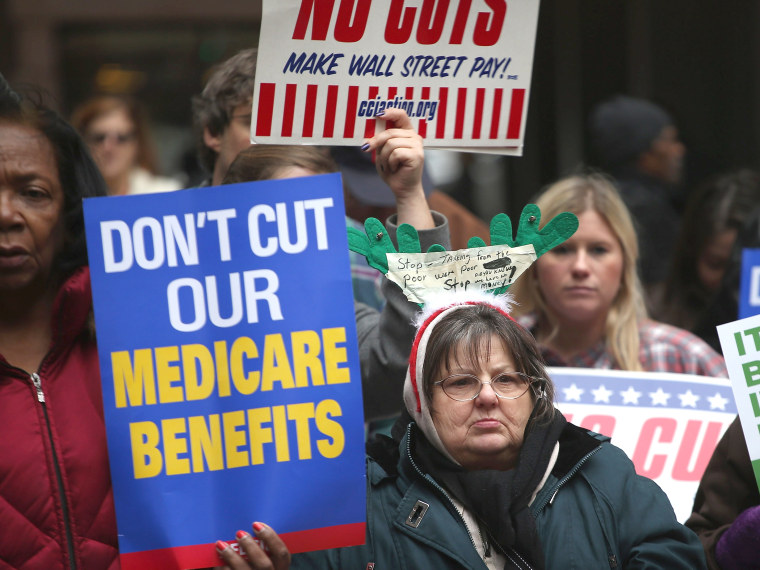 Protestors call for an increase of taxes on the wealthy and voice opposition to cuts in Social Security, Medicare, and Medicaid during a demonstration in the Federal Building Plaza on December 6, 2012 in Chicago, Illinois.  About 300 protestors...