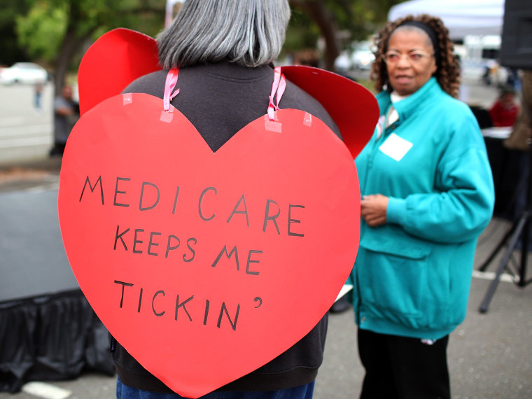 File Photo: A senior citizen holds a sign during a rally to protect federal health programs at the 8th Annual Healthy Living Festival on July 15, 2011 in Oakland, California.  (Photo by Justin Sullivan/Getty Images/FIle)