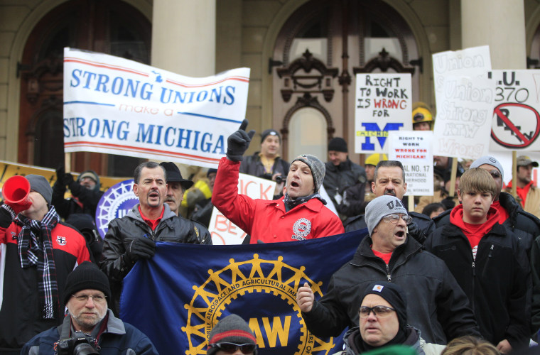 Large right-to-work protests, like the one here in Lansing, MI, are expected throughout the state today.(AP Photo/Carlos Osorio)
