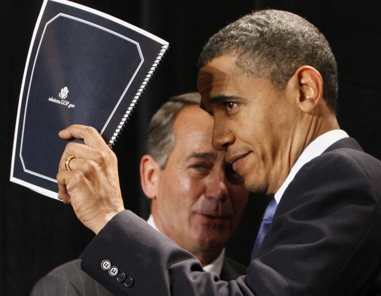 File Photo: President Barack Obama holds up a document of Republican solutions given to him by House Minority Leader John Boehner of Ohio, before addressing Republican lawmakers at the GOP House Issues Conference, in Baltimore, Friday, Jan. 29, 2010. ...