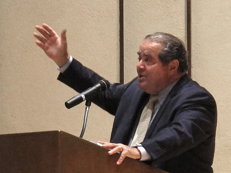 File Photo: U.S. Supreme Court Justice Antonin Scalia speaks at the University of Wyoming in Laramie Thursday, Oct. 25, 2012. Passing through Laramie after an unsuccessful antelope hunt, Scalia stopped at the university to make an impassioned and...