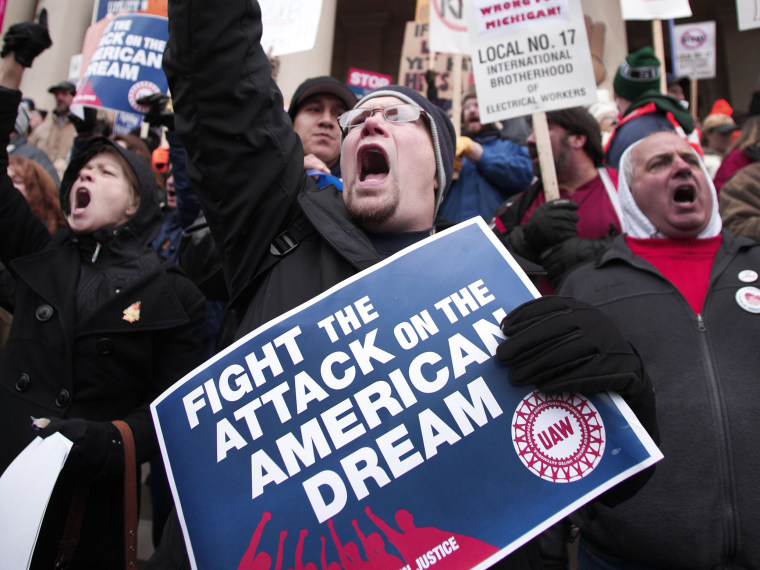 Craig Cable, of Newport, Michigan, a member of United Auto Workers Union Local 3000, and union members from around the country, rally at the Michigan State Capitol to protest a vote on Right-to-Work legislation December 11, 2012 in Lansing, Michigan....