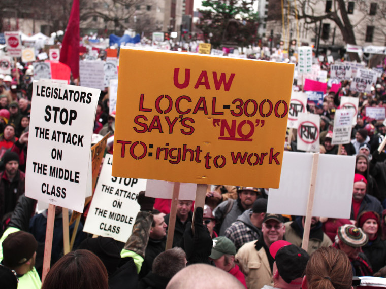 Union members from around the country rally at the Michigan State Capitol to protest a vote on Right-to-Work legislation December 11, 2012 in Lansing, Michigan. (Photo by Bill Pugliano/Getty Images)