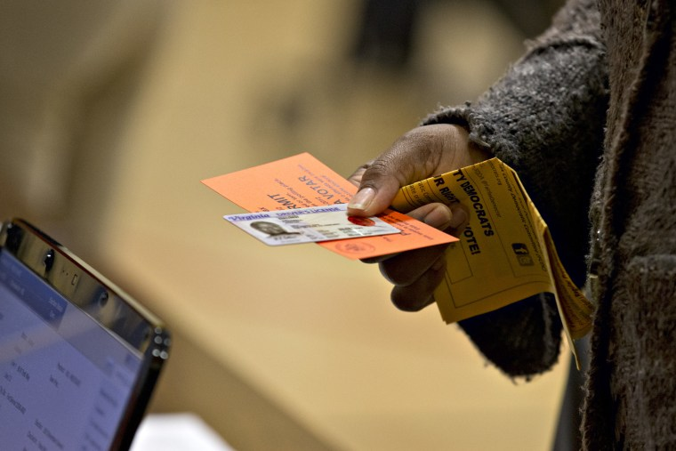 Voter casts a ballot in Fairfax County, Virginia (Photo by J. Scott Applewhite/AP)