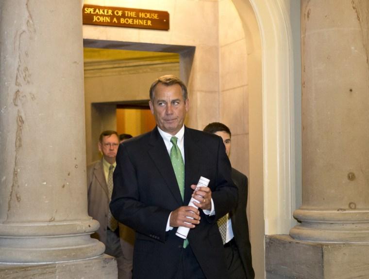 House Speaker Boehner leaves his office and walks to the House floor. (AP Photo/J. Scott Applewhite)