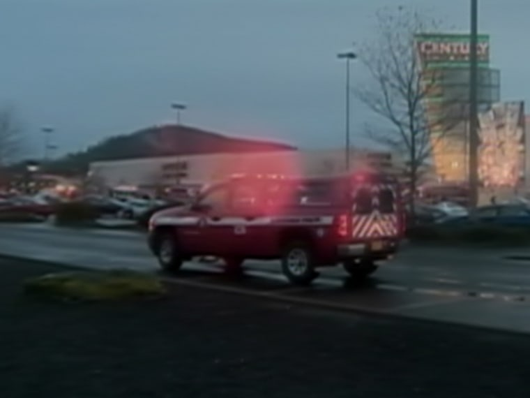 An ambulance rushes toward a mall in Portland, Oregon where a deadly shooting occurred Tuesday evening