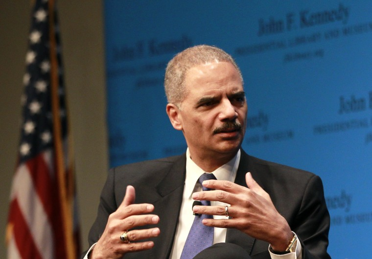 U.S. Attorney General Eric Holde responds to a question during a forum at the JFK Kennedy Library and Museum, in Boston, Tuesday, Dec. 11, 2012 (Photo by Steven Senne/AP)