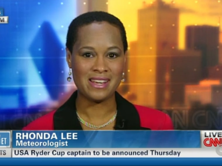 In this screenshort taken from CNN, meteorologist Rhonda Lee reacts after KTBS TV station fired her after she replied to viewer criticism of her natural hairstyle.