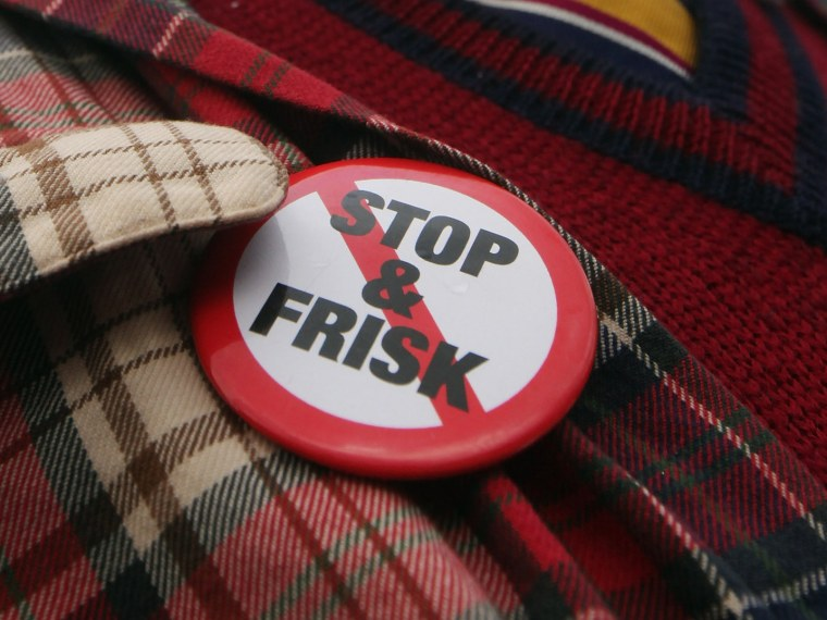 """File Photo: An opponent of the New York Police Department's controversial \""""stop-and-frisk\"""" policy march on January 27, 2012 in New York City. (Photo by Mario Tama/Getty Images/File)"""