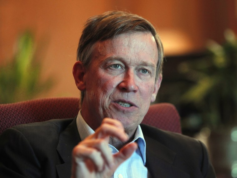 Colorado Gov. John Hickenlooper is pictured during an interview with the Associated Press at his office in the Capitol in Denver on Wednesday, Dec. 12, 2012. Colorado's governor says it's time the state considered gun control measures, almost five...