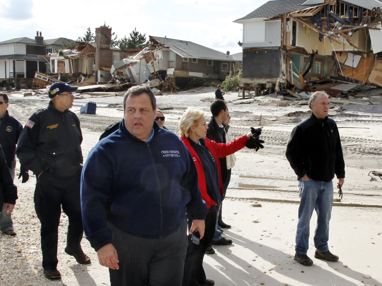 New Jersey Gov. Chris Christie walks past damaged homes along the Atlantic Ocean Friday, Nov. 2, 2012, in Mantoloking, N.J., as they tour some of the region devastated by Monday's storm surge by superstorm Sandy. (Photo by Mel Evans/AP Photo/Pool)