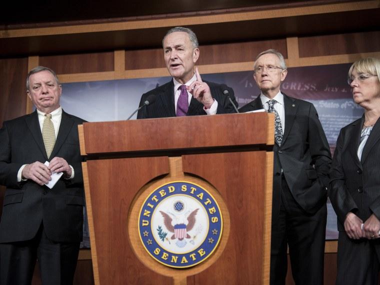(L-R) Senate Majority Whip Senator Richard Durbin (D-IL), Senate Majority Leader Senator Harry Reid (D-NV) , and Senator Patty Murray (D-WA) listen as Senator Charles E. Schumer (D-NY) speaks during a press briefing on Capitol Hill 13, 2012 in...