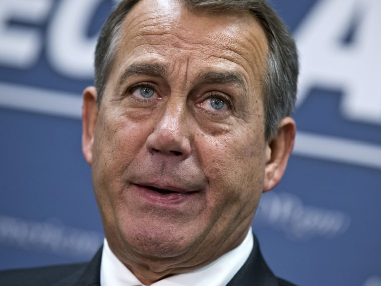 House Speaker John Boehner, who conferred with President Barack Obama by phone yesterday, speaks to reporters on Capitol Hill in Washington, Wednesday, following a closed-door meeting with the GOP caucus. (AP Photo/J. Scott Applewhite)