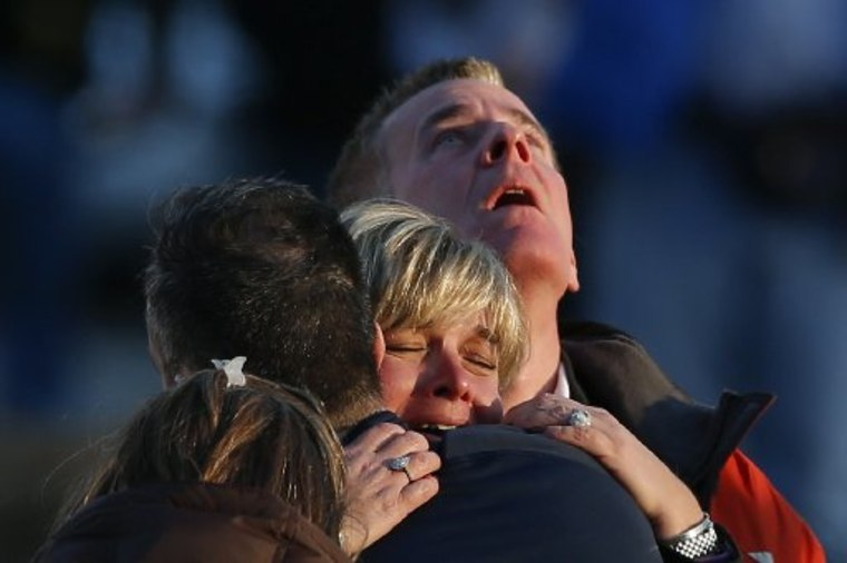 The families of victims grieve near Sandy Hook Elementary School, where a gunman opened fire on school children and staff in Newtown, Connecticut on December 14, 2012. (Photo by Reuters/Adrees Latif)