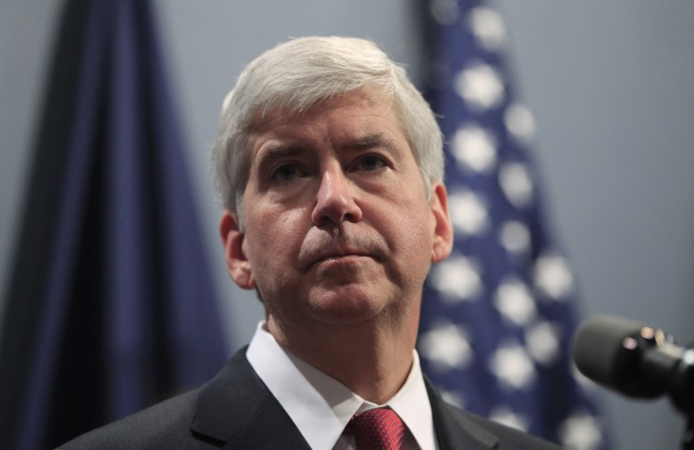 """Gov. Rick Snyder says he's giving \""""extra consideration\"""" to a bill that would make it easier to carry guns in Michigan schools (Photo by Carlos Osorio/AP)"""
