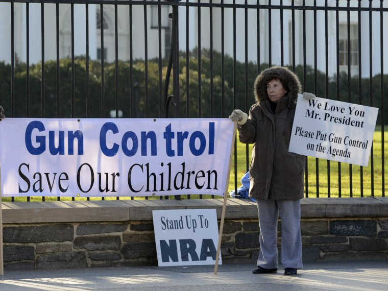 Supporters of gun control hold a sign that reads 'Gun Control Save Our Children', outside the White House in Washington DC, USA, 15 December 2012.  Reports state on 14 December 2012 that a gun man unleashed a hail of gunfire that killed 20 children and...
