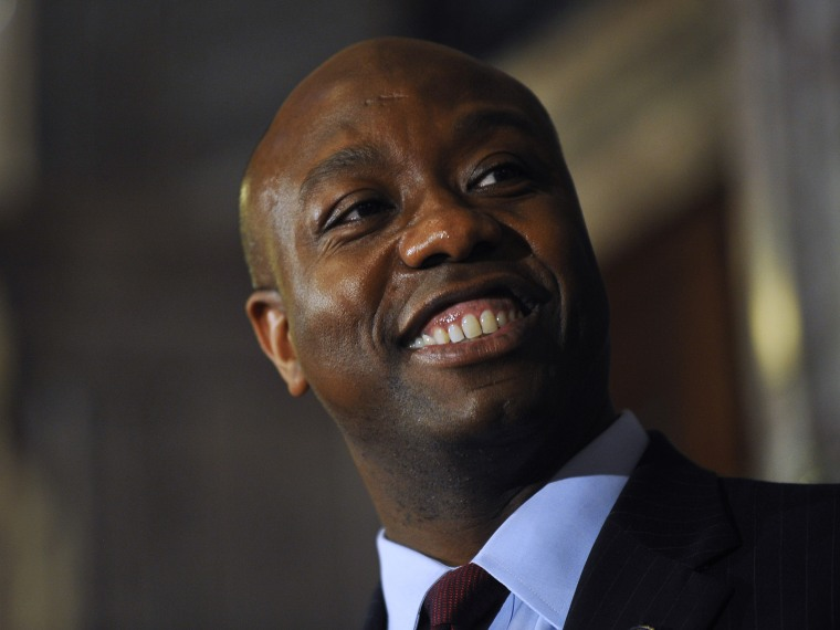 U.S. Rep. Tim Scott smiles during a press conference announcing him as Jim DeMint's replacement in the U.S. Senate at the South Carolina Statehouse on Monday, Dec. 17, 2012, in Columbia, S.C.  (Photo by Rainier Ehrhardt/AP Photo)