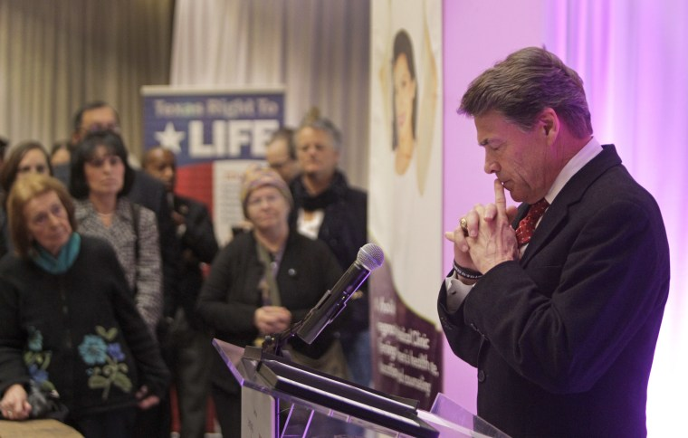 Governor Rick Perry pauses as he speaks during media conference at The Source for Women, Tuesday, Dec. 11, 2012, in Houston. (AP Photo/Houston Chronicle, Melissa Phillip)