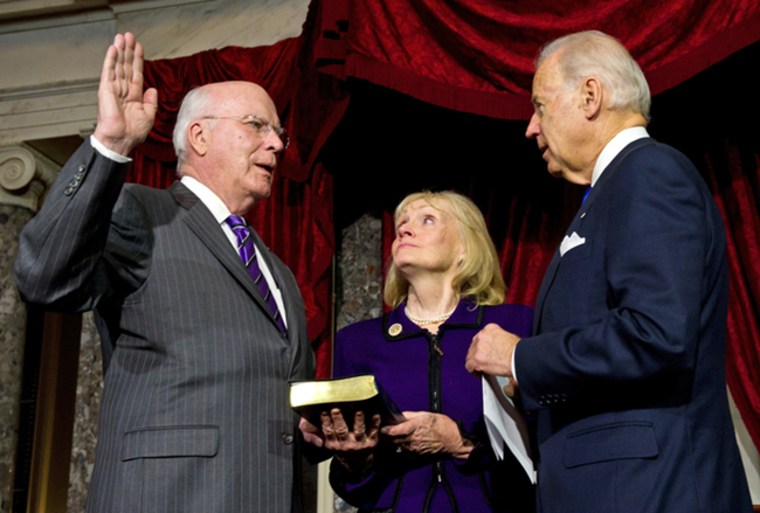 US Vice President Joe Biden(R) administers the oath of office to US Senator Patrick Leahy(L),D-VT, to be president pro tempore of the Senate as his wife Marcelle holds the Bible on December 18, 2012 AFP PHOTO/Karen BLEIERKAREN BLEIER/AFP/Getty Images