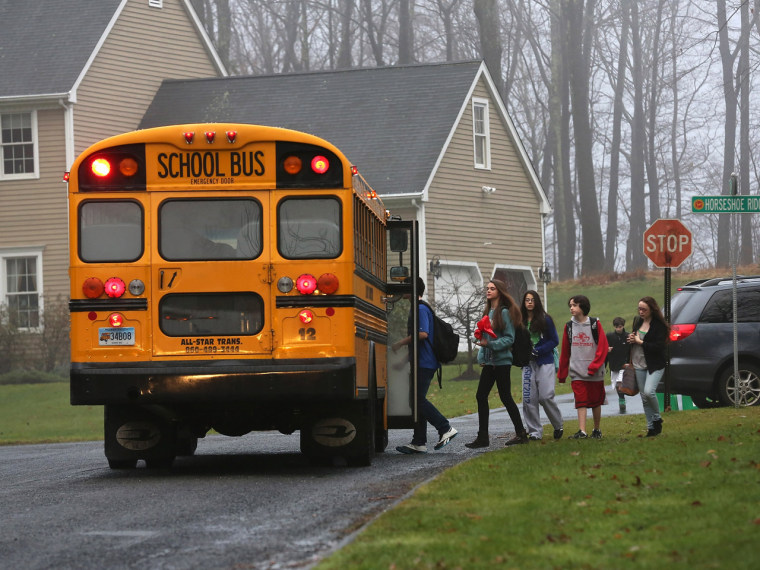 Children return to school on December 18, 2012 in Newtown, Connecticut, four days after the Sandy Hook Elementary massacre. (John Moore/Getty Images)