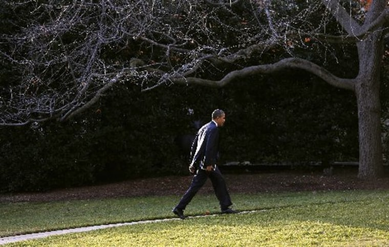 U.S. President Barack Obama walks back to the Oval Office of the White House in Washington December 18, 2012. REUTERS/Kevin Lamarque