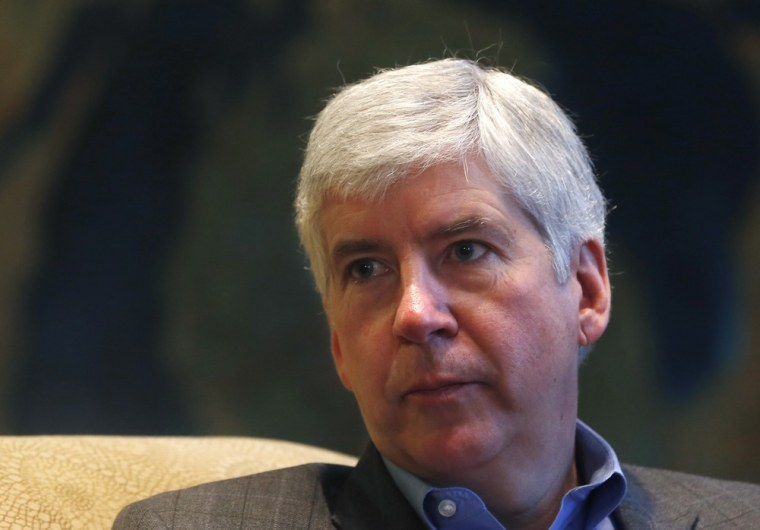 Michigan Gov. Rick Snyder is interviewed in his office in Lansing, Mich., Monday, Dec. 17, 2012. (AP Photo/Carlos Osorio)