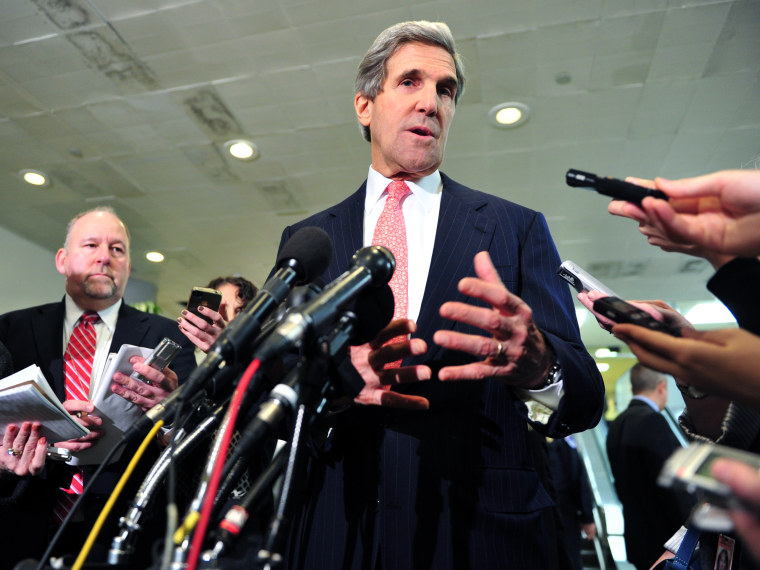 US Senate Foreign Relations Committee Chairman Sen. John Kerry (C), D-MA, speaks to reporters on December 19, 2012 on Capitol Hill in Washington, DC  following a full committee closed door briefing on the Benghazi. (Photo by Karen Bleier/AFP/Getty Images)