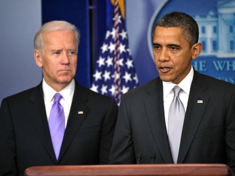 US President Barack Obama speaks as Vice President Joe Biden looks on as he delivers a statement in the Brady Briefing Room of the White House on December 19, 2012 in Washington, DC. Obama will appoint Vice President Joe Biden to lead a panel tasked...
