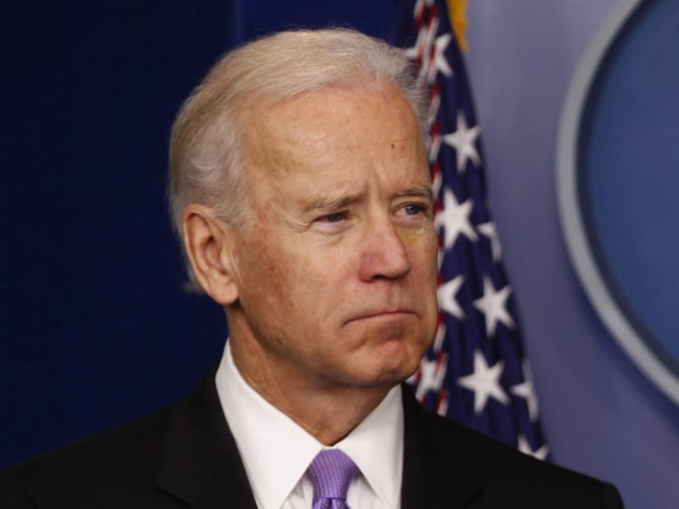Vice President Joe Biden looks on as the U.S. President Barack Obama speaks to members of the media in the White House Briefing Room December 19, 2012. Obama announced that Biden will lead an effort to come up with policies to address gun violence...