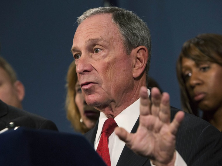 """New York City Mayor Michael Bloomberg (C), along with survivors and family members of gun violence victims, addresses the media as part of the Mayors Against Illegal Guns group, to announce the release of 34 """"I Demand a Plan"""" videos in New York..."""