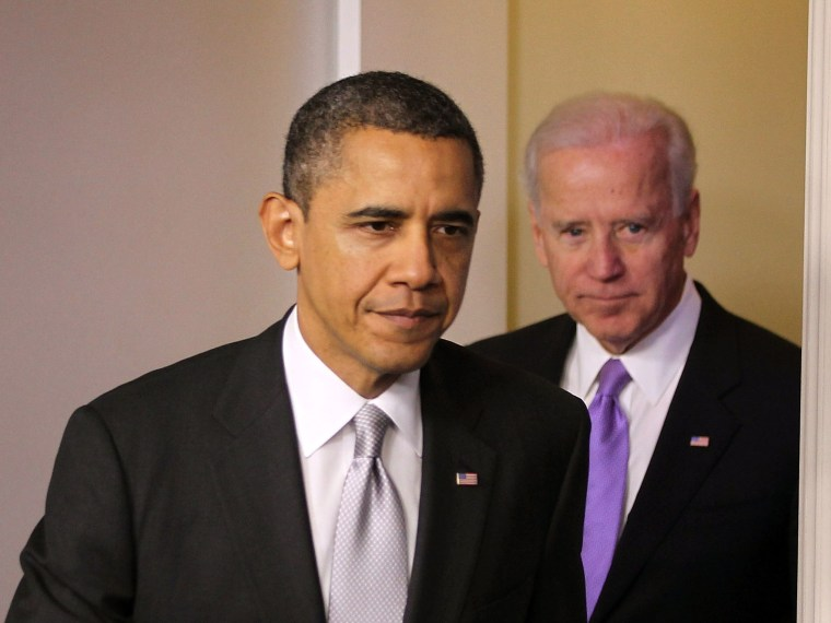 U.S. President Barack Obama (L) and Vice President Joseph Biden (R) arrive at an announcement on gun reform in the James Brady Press Briefing Room of the White House December 19, 2012 in Washington, DC. President Obama announced that he is making an...