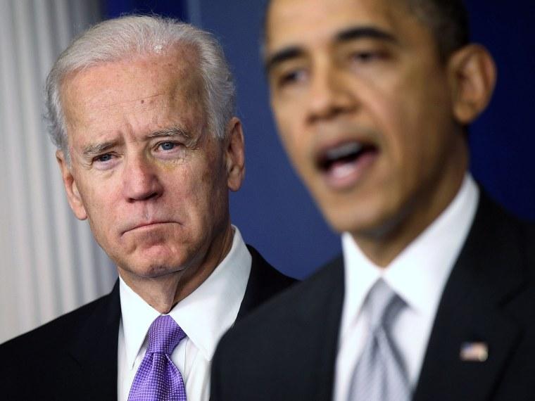 U.S. Vice President Joseph Biden (L) listens as U.S. President Barack Obama speaks during an announcement on gun reform in the Brady Press Briefing Room of the White House December 19, 2012 in Washington, DC. President Obama announced that he is making...