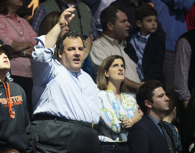This image released by Starpix shows New Jersey Gov. Chris Christie, center, at the 12-12-12 The Concert for Sandy Relief at Madison Square Garden in New York on Wednesday, Dec. 12, 2012. (AP Photo/Starpix, Dave Allocca)