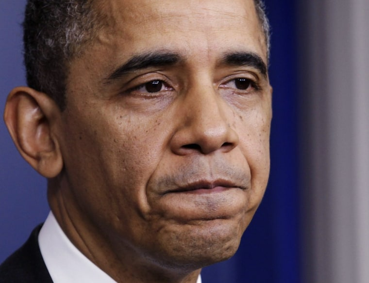 """U.S. President Barack Obama pauses as he speaks to the media about the \""""fiscal cliff\"""" in the White House Briefing Room in Washington December 19, 2012. (REUTERS/Yuri Gripas)"""