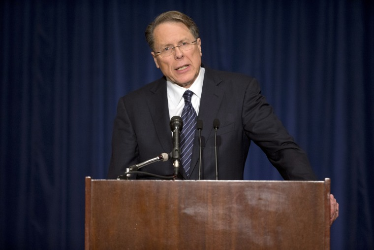 National Rifle Association Executive Vice President Wayne LaPierre calls on Congress to pass a law putting armed police officers in every school in America during a news conference Dec. 21, 2012 in Washington, DC.  (Photo by Evan Vucci/AP Photo)